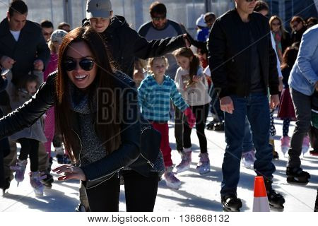 Sydney Australia - July 3 2016. Girl skating on the ice rink at Hyde Park. The Winter Festival's in Sydney are Australia's largest winter events featuring open-air ice-skating.