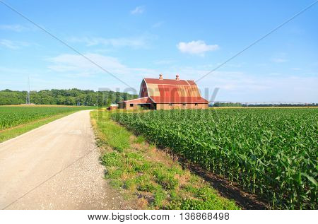 Beautiful farm landscape with red barn