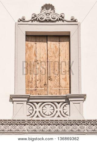 Decorated window of an Italian neoclassical villa.