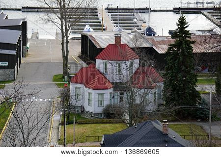 HARBOR SPRINGS, MICHIGAN / UNITED STATES - JUNE 11, 2015: The Hexagon House, designed by Ephraim Shay as his home in 1892, can be seen from the top of the bluff above downtown Harbor Springs.