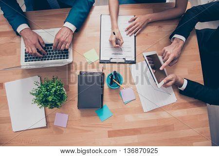 Top View Of Workstation Of Businesspeople Working With Laptop, Tablet And Folder