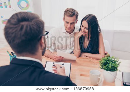Real Estate Agent Helping Young Family To Buy Flat