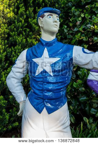 White Star Metal Jockey statue with white pants