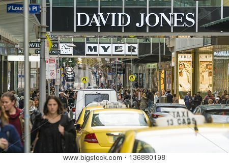 Melbourne, Australia - Jul 2, 2016: People walking along Little Bourke street in downtown Melbourne, Australia. It is a popular shopping area with major department stores such as Myer and David Jones.