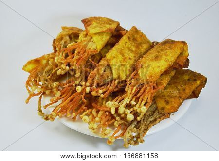 Enokitake mushroom fried wonton wrapper on dish