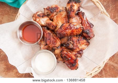hot and spicy chicken wings with dip and hot sauce
