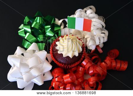 Italian Republic Day cupcake with red white and green italian flag. National Liberation Day. Festa della Repubblica Italiana. Italy flag on cupcake.