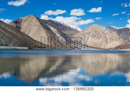 Sunny day at Pangong Lake. Pangong Lake is an endorheic lake in the Himalayas situated at a height of about 4350 m. It is 134 km long and extends from India to China