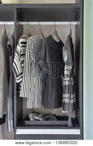 Row Of Black And White Dress In Wardrobe At Home