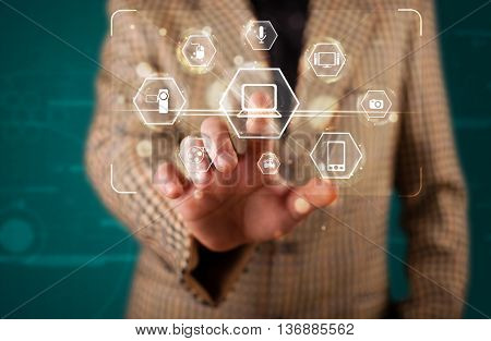 Young businessman pressing virtual media type of buttons