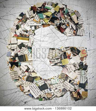 The letter G  made from newspaper confetti