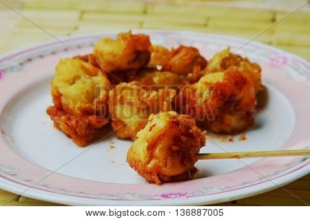 deep fried fish ball and wooden stick