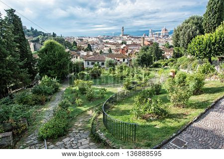 View from Giardino delle Rose to the city of Florence. Tuscany Italy. Travelling scene. Beautiful place. Greenery and town. Cradle of the renaissance. Cultural heritage.