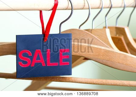 Sale of clothing concept with empty hangers
