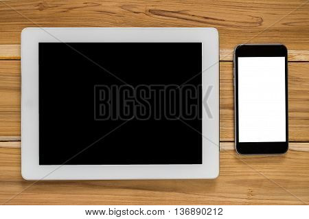 Office stuff with blank screen smartphone and blank screen tablet.Top view office gadgets .