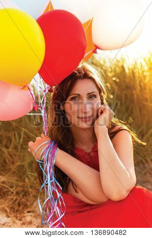 sitting dreaming romantic lady in field