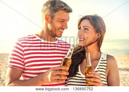 summertime travel couple enjoying sunset