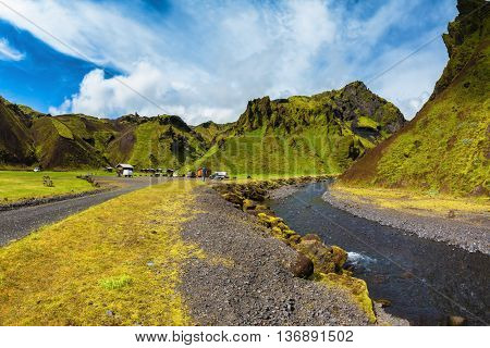 Camping in valley of canyon Pakgil. The canyon flowing fast shallow creek. Summer blooming Iceland. The photo was taken Fisheye lens
