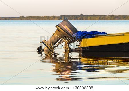 Part of a small motorboat is waiting at the shore