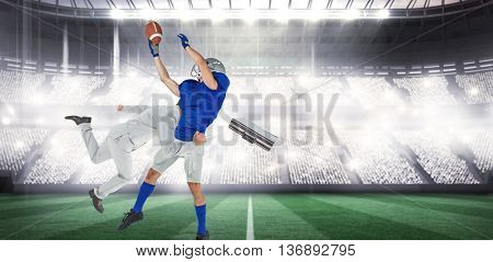 Businessman tackling a football player against sports arena