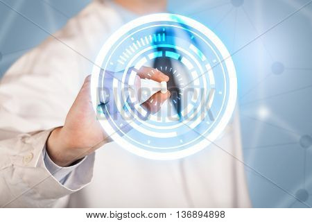 A male  doctor in white coat showing a glowing pill in blue, white circles