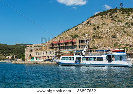 Sevastopol, Russia - June 09, 2016: Tourist ship in the Balaclava Bay. Former submarine base.