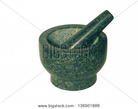 Stone mortar of black marble grinding spices and ingredients.