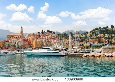 colorful houses of Menton old town harbor at summer day, France, retro toned