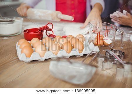 Cropped image of woman preparing food in kitchen at home