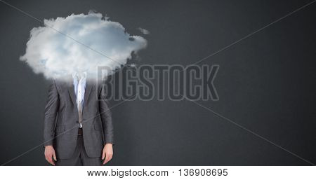 Businessman in grey suit frowning at camera against grey background