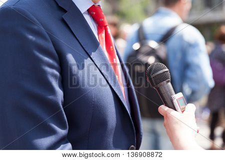 Media interview with politician, businessman or spokesman