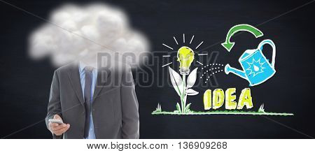 happy business man using smartphone against blackboard