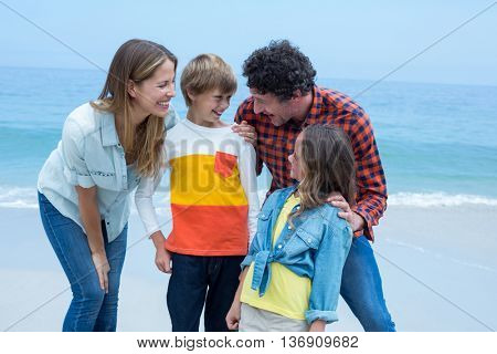 Parents enjoying with children on shore at beach