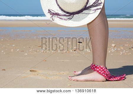 Woman At The Beach Holding Hat Having Bikini On Foot