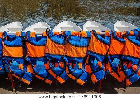 Orange life jackets close up outdoors safety