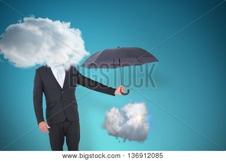 Businessman holding black umbrella beside him against blue vignette background