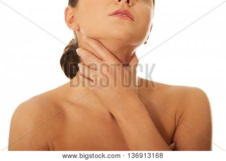 Woman having throat pain