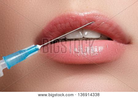 Close-up Of Beautiful Woman Gets Injection In Her Lips
