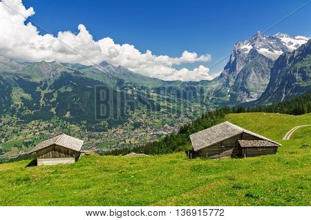 Beautiful idyllic mountains landscape with country house (chalet) in summer, Alps, Switzerland