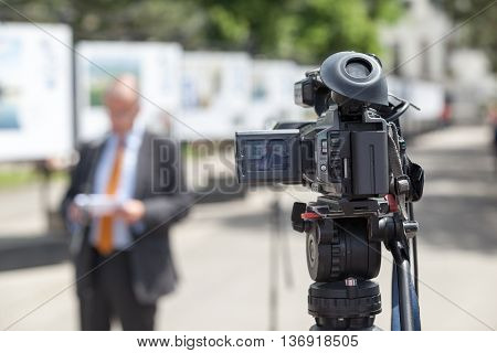 Filming news event with a video camera