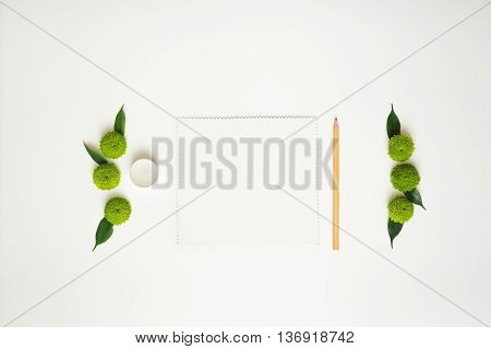 Paper, Pencil And Candle With Decoration.