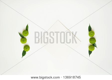 Paper With Decoration Of Chrysanthemum Flowers And Ficus Leaves.
