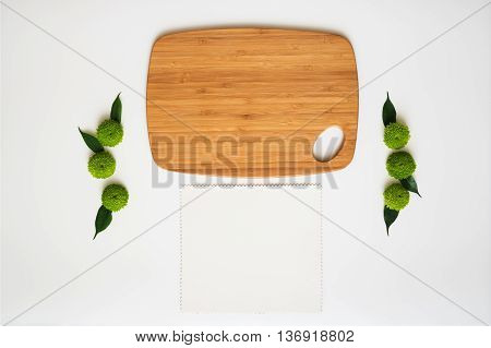 Wooden Cutting Board And Paper With Decoration.