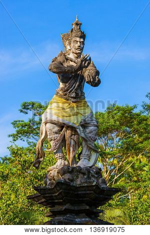 Statue in Tirta Empul Temple on Bali Island Indonesia - travel and architecture background