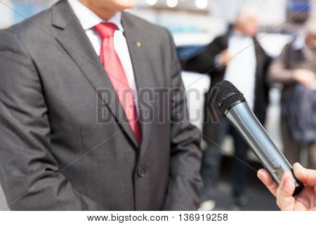 Press interview. Media interview with businessman or politician.