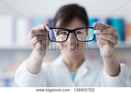 Optometrist Giving Glasses To The Patient