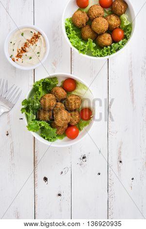 Vegetarian falafels ball in bowl and hummus