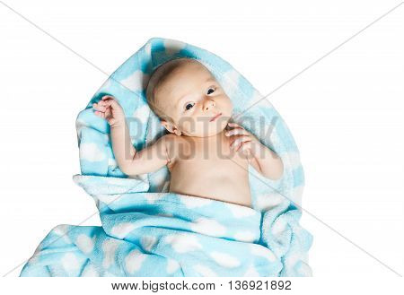 Newborn baby lying in a blue towel after taking a bath isolated on white background. Bathing children. Children's Care.