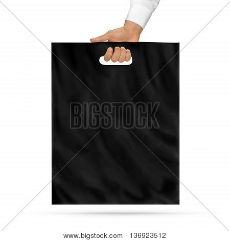 Blank black plastic bag mock up holding in hand. Empty polyethylene package mockup hold in hands isolated on white. Consumer pack ready for logo design or identity presentation. Product packet handle.