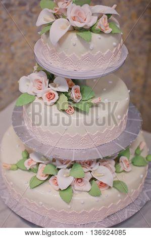 beautiful wedding cake with flowers close up.
